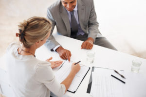 Small Business Loans Signing Paperwork
