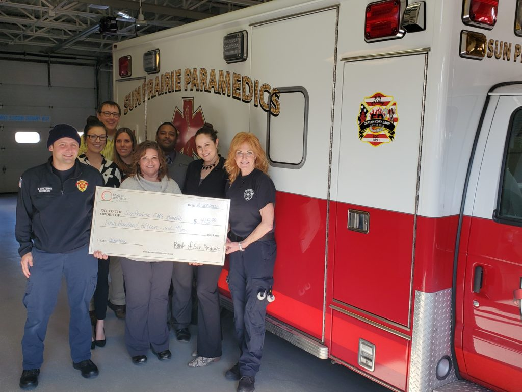 Bank Sun Prairie Community EMS Donation Group in front of Ambulance